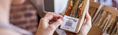 Sandwich labelled with barcode and price, printed on a Brother label printer