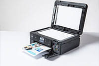 Black inkjet printer printing colourful document with copier lid open - MFC-J890DW