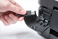black inkjet printer with hand inserting USB stick - MFC-J890DW