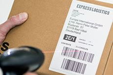 QL-1110NWB label affixed to a parcel being scanned