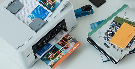 Printer on table printing colour document