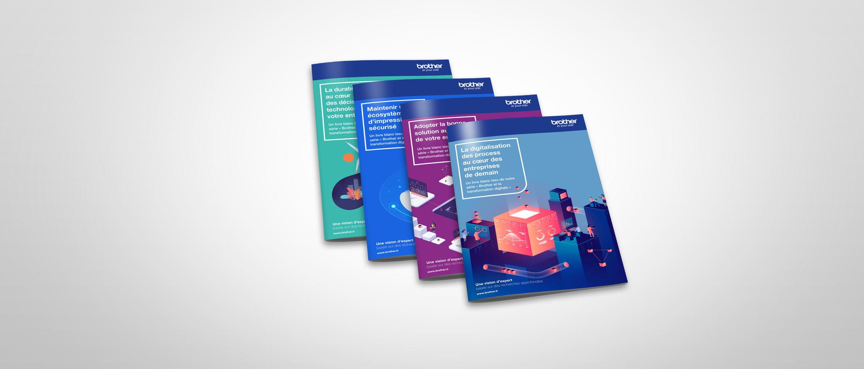Quatre brochures différentes sur fond gris