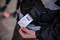 RJ 2 inch printing receipt on shoulder strap on enforcement officer