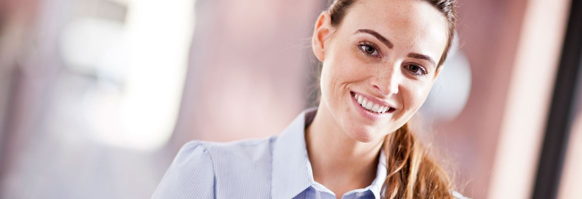 Woman at work smiles office