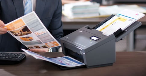 Man picking up scanned document