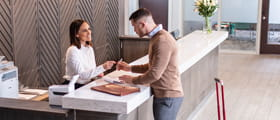 Woman and man signing in register
