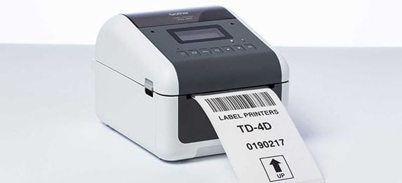 Brother TD label printer with label being printes