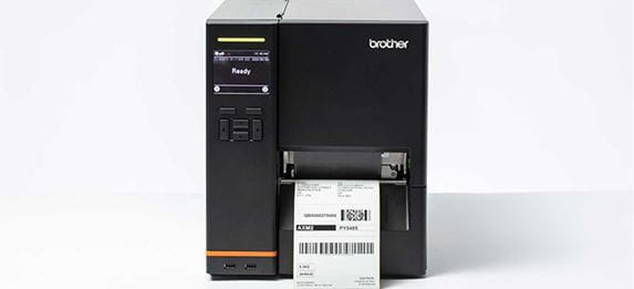 Brother black TJ industrial label machine with label being printed