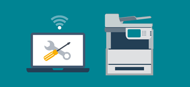 Printer next to laptop with spanner and screw driver and wifi icon on top