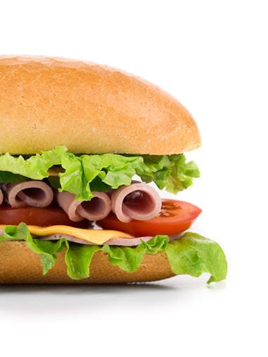 Subway sandwich with ham, cheese, lettuce and tomato