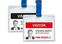 Black and red visitor badges printed on a Brother QL-820NWBVM badge printer
