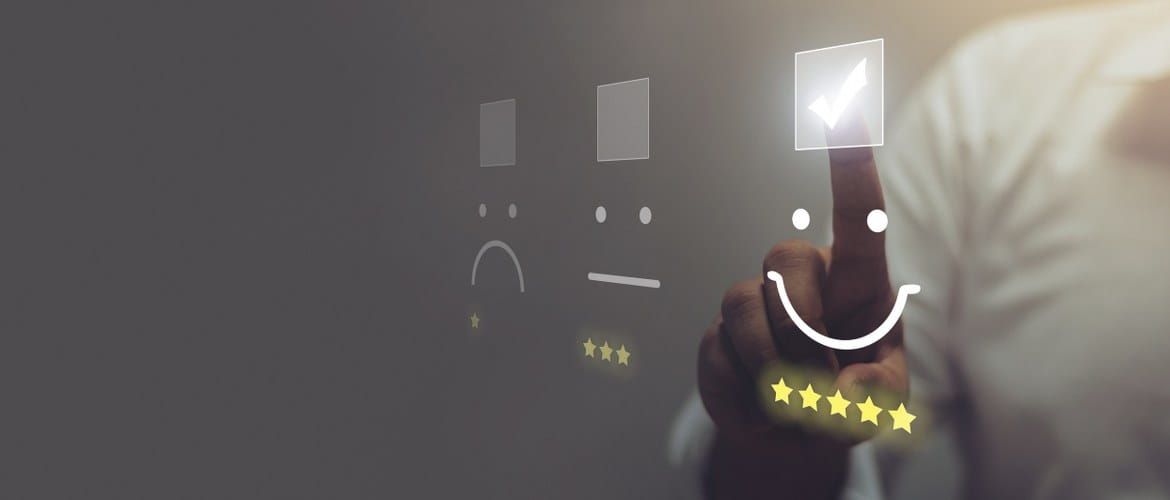 Office of the future image depicting customer experience with positive review star ratings and smiling faces being selected via a clear touchscreen wall