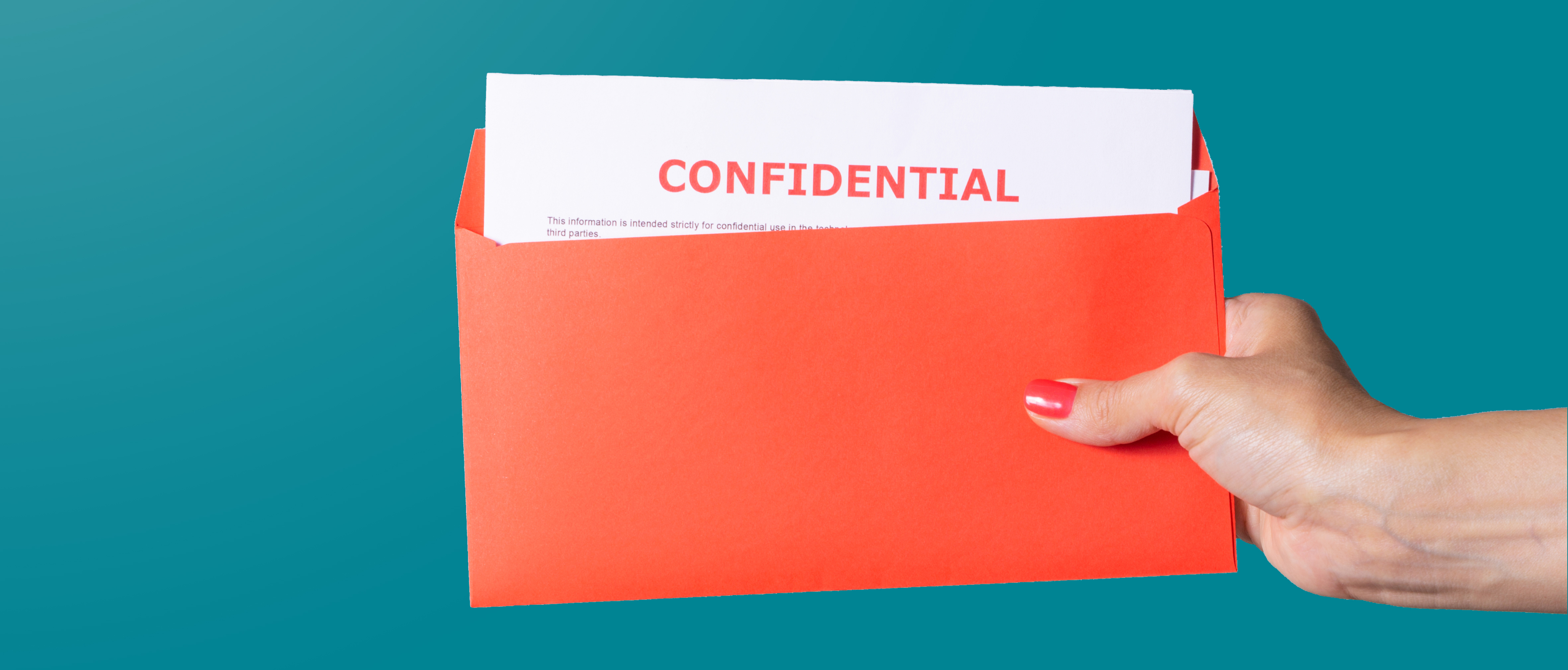 a hand from outside of the frame holding a coral coloured envelop with white documents inside with the words confidential in red written at the top, all against a solid teal background