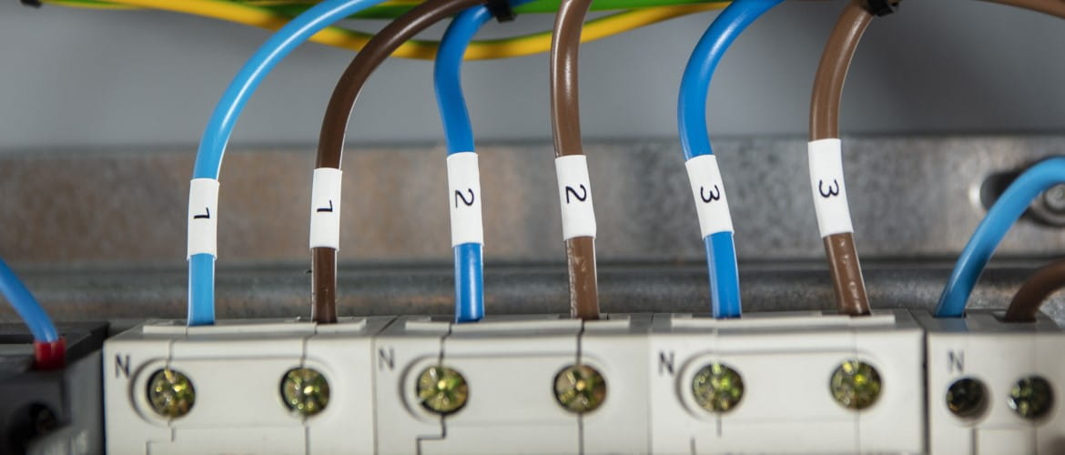 "A top-down view of six alternating brown and blue cables labelled in pairs with ""1"", ""2"", and ""3""."