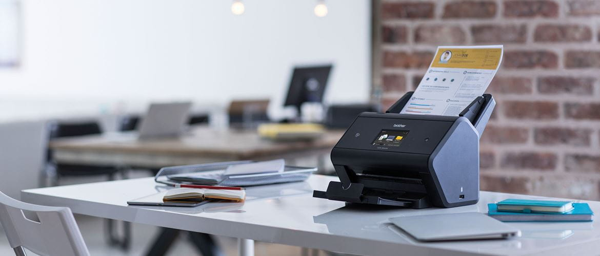 ADS-3600W scanner in a busy office with output