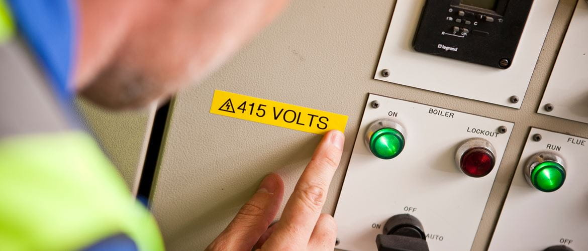 Yellow warning label on an electrical panel
