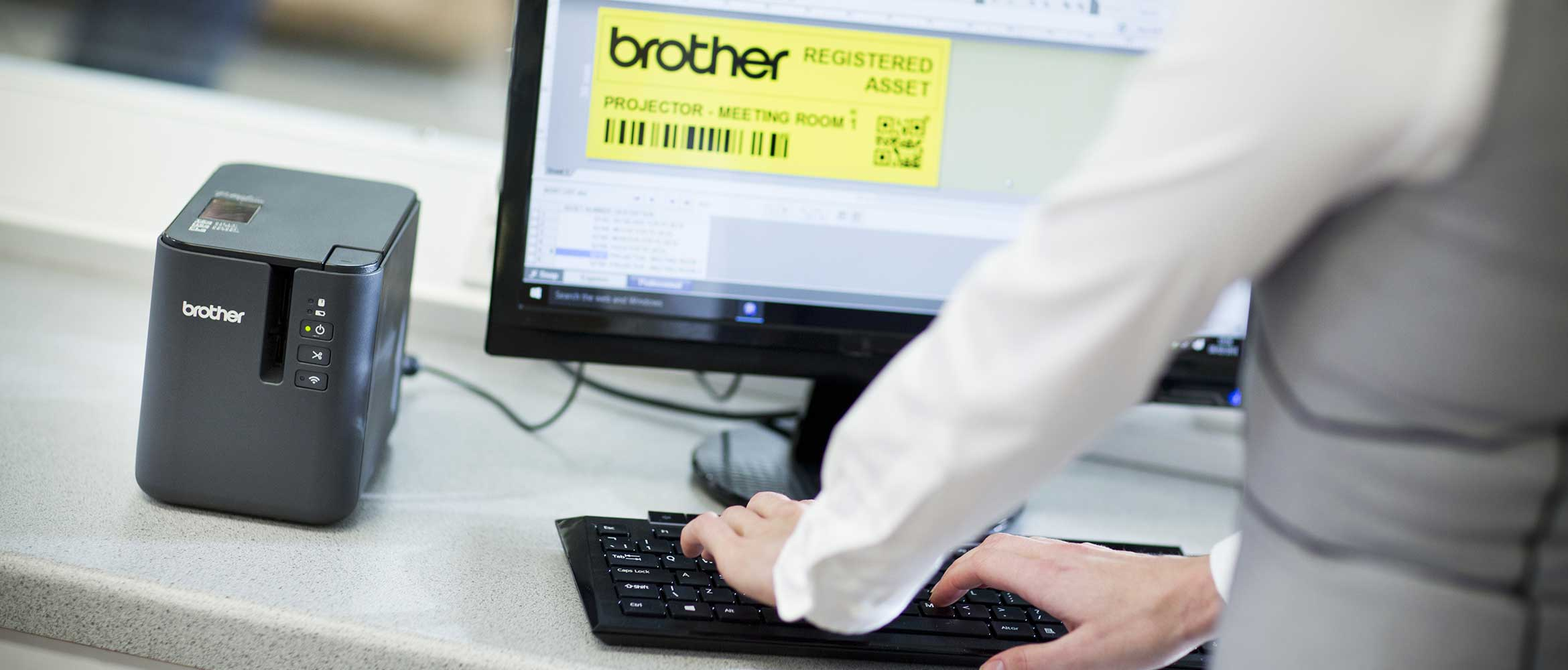 Brother PT-P900 series label printer on a desk