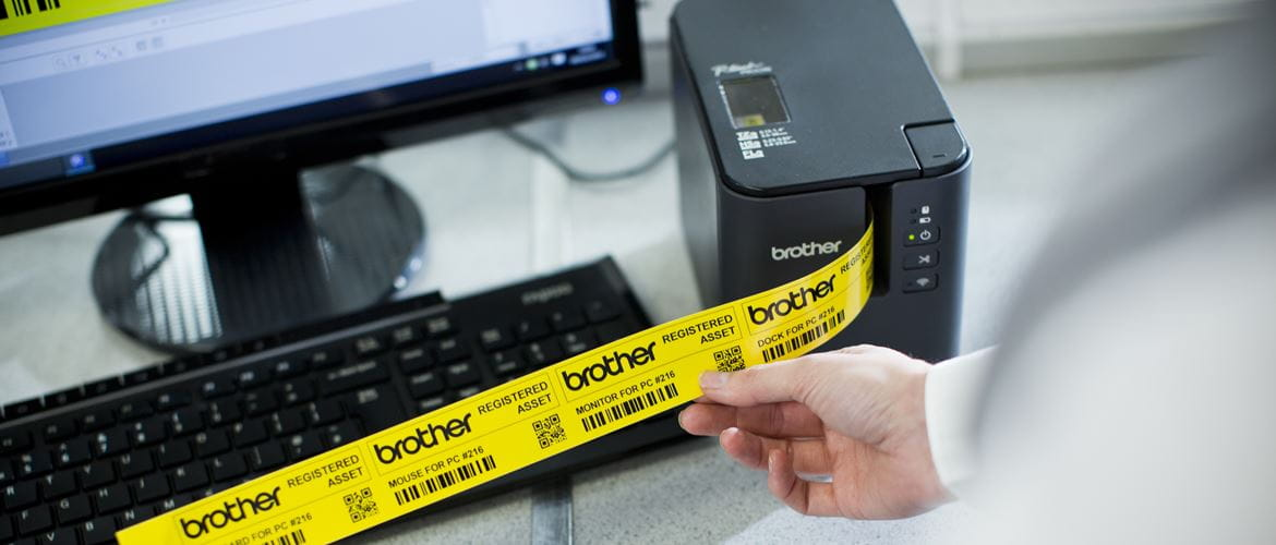P-touch P900W label printer with yellow Pro Tape being printed
