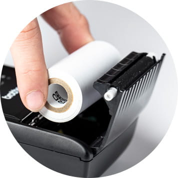 Hand placing receipt roll into Brother RJ printer