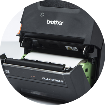 Brother RJ mobile printer open showing roll of white labels