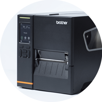 Black label printer with label being printed, black menu screen, white icons, boxes