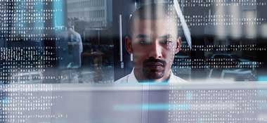 Man in white shirt surrounded by data