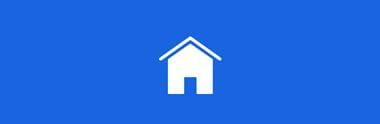 blå firkant med hvidt hus i midten