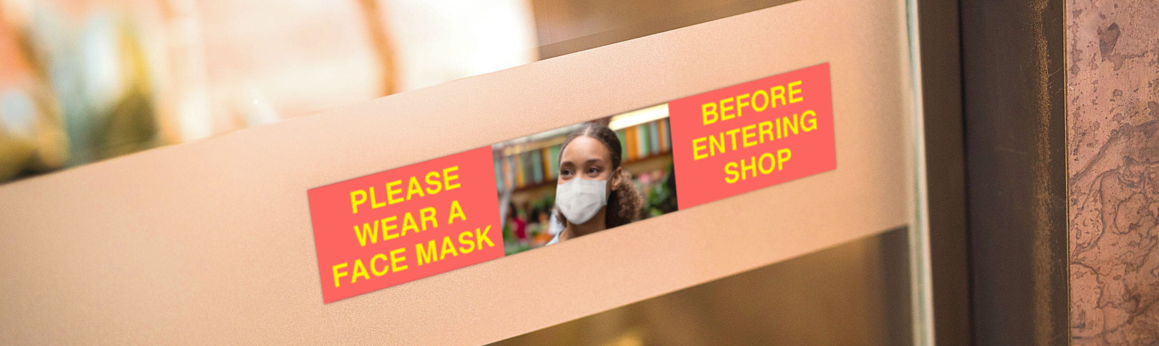 Full colour sign on shop door asking customers to wear a mask