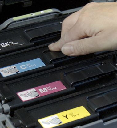 Person putting toner cartridge into a printer