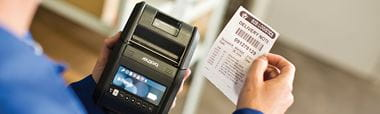 Brother RJ portable label printer with barcode label being printed