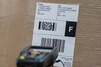 High quality thermal barcode label on brown box being scanned