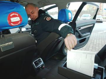 Litauens politi kjører rundt med en Brother PcketJet i baksetet