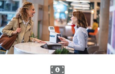 Woman serving female customer at checkout