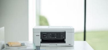 Brother MFC-J497DW inkjet printer on desk in home office