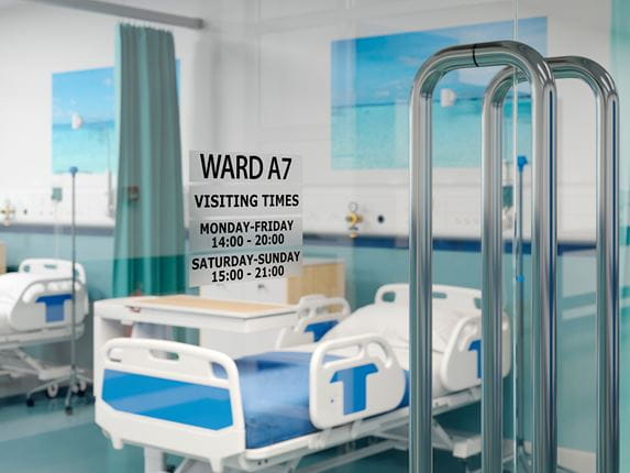 P-touch black on clear TZe labels on glass door for facilities management showing times of hospital ward opening