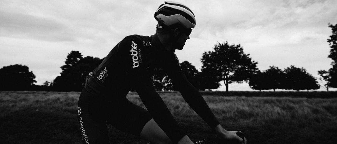 Racing cyclist, profile, black and white