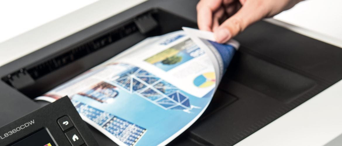 Close-up of a person revealing the underside of a double sided printed document