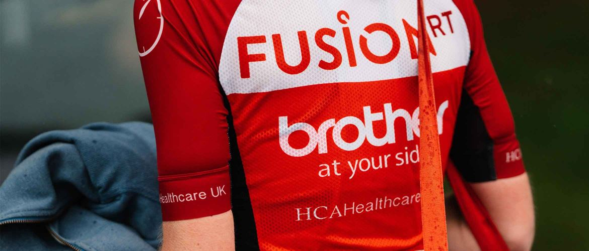 The back of Team Fusion RT's cycling jersey with the Brother logo