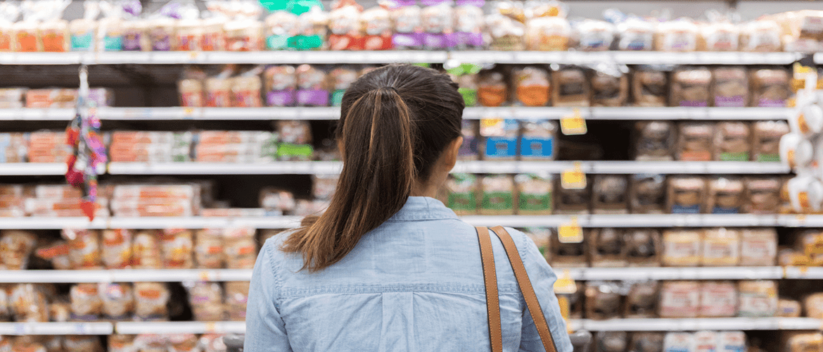 Shopper in the bread aisle at a supermarket