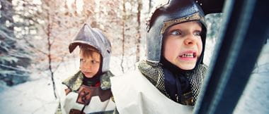 two boys dressed as knights go into battle
