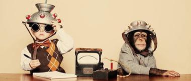 boy and a monkey sit behind a desk