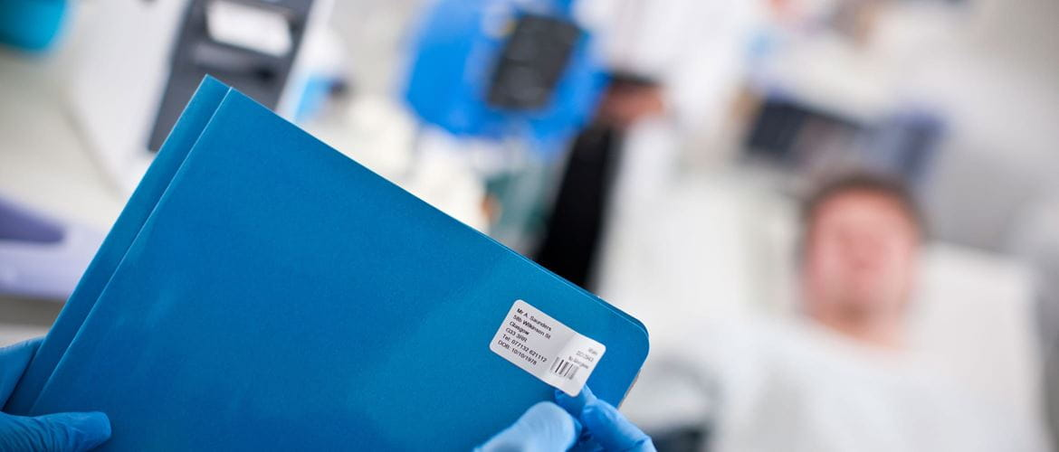 Doctor labelling a patient file