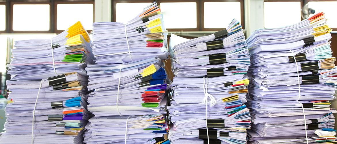 bundles of paper stacked high