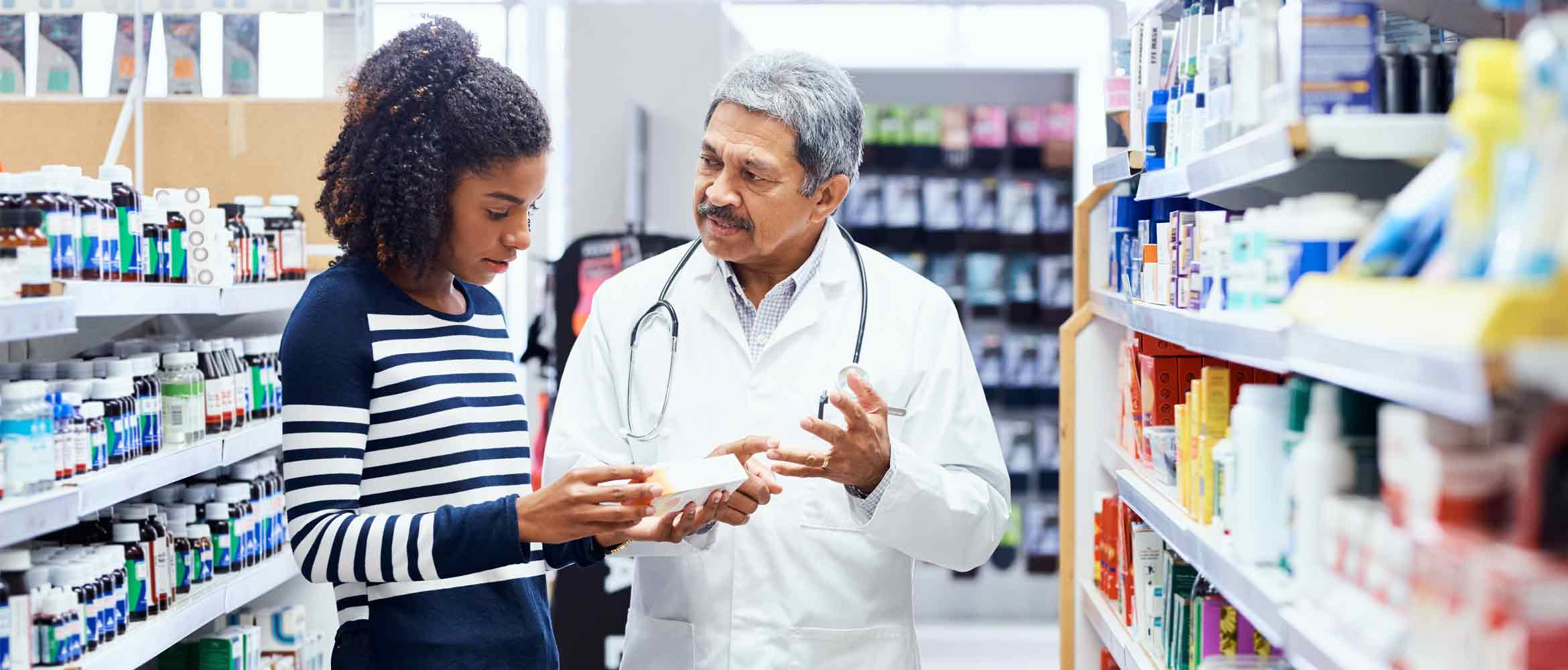 Pharmacist and a customer chatting about a product