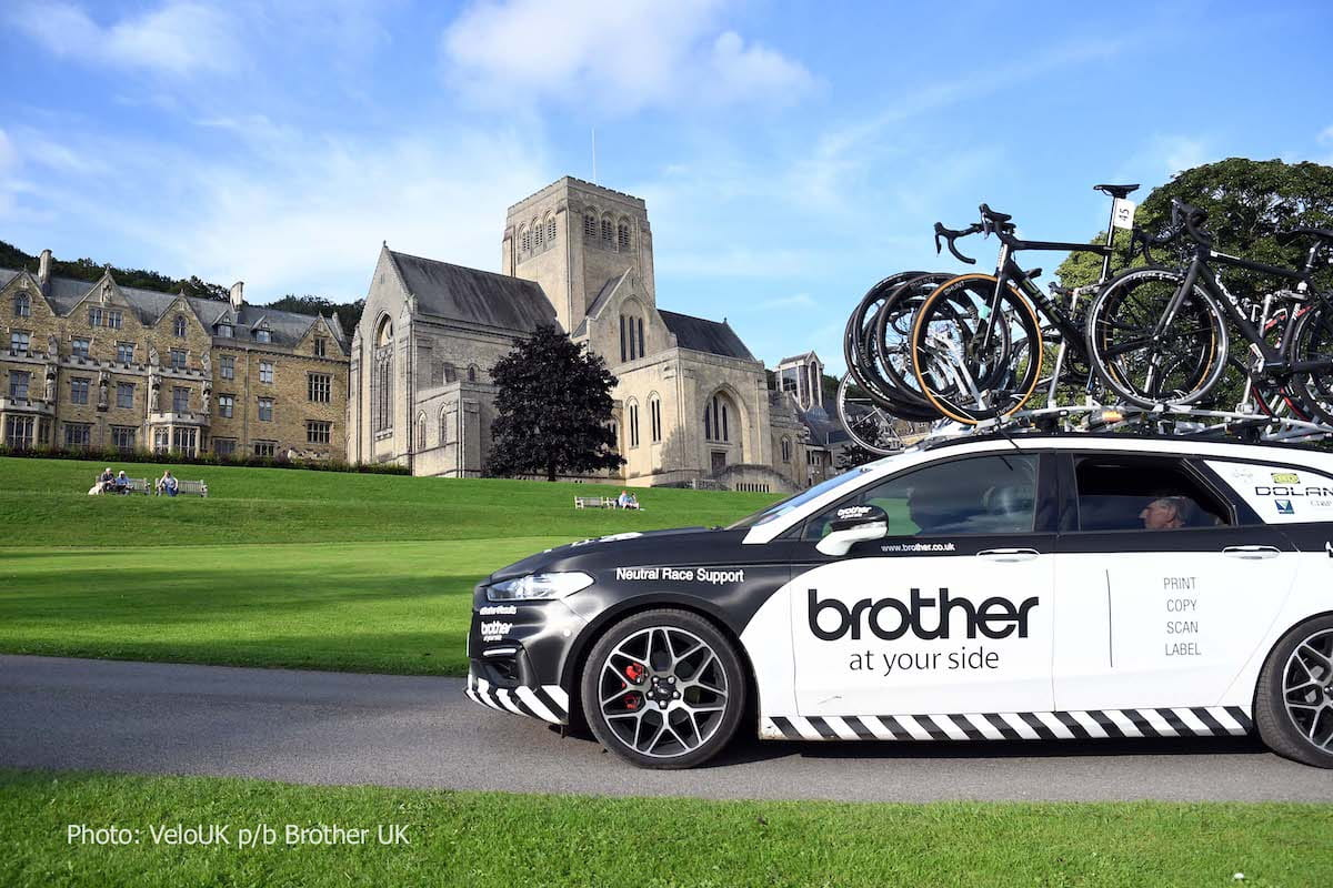 Branded car with bicycles on roof