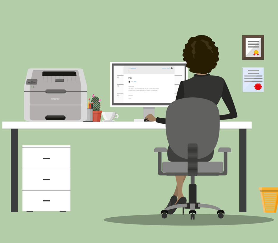 woman sat at desk with computer and printer