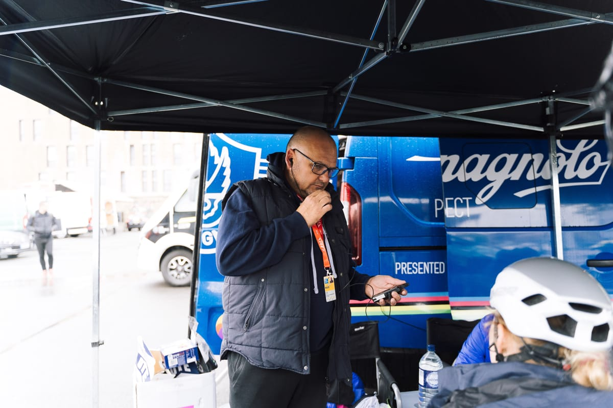 Brother UK-Tifosi p/b OnForm team member talking handsfree on his phone in front of a support vehicle