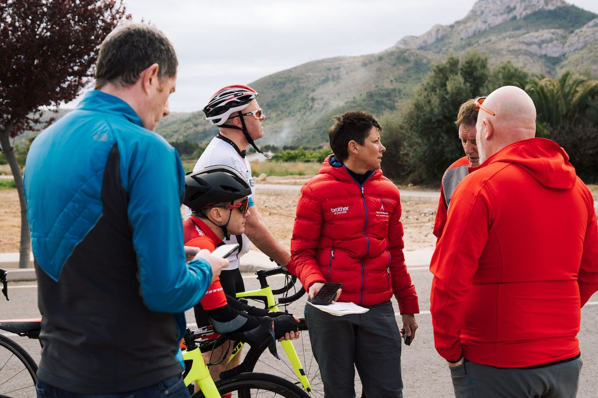 Cherie Pridham organising an ad-hoc time-trial by the roadside as Phil Jones MBE encourages the riders