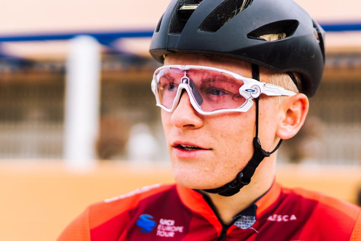 Liam Davies wearing Vitus Pro Cycling Team kit, helmet and glasses