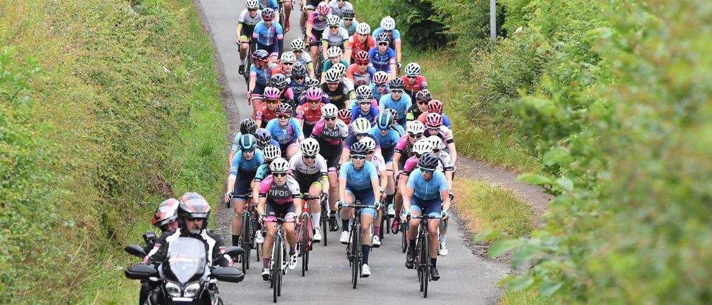 Racing cyclists, female, bunch, riding towards camera